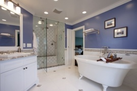 Bright-white-wainscot-tile-keeps-the-space-clean-and-bright-while-contrasting-the-bold-wall-color